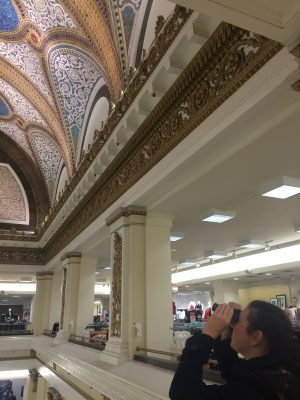 Kelly Conway views the mosaic dome through binoculars at Macy's (formerly Marshall Field & Company) in Chicago.