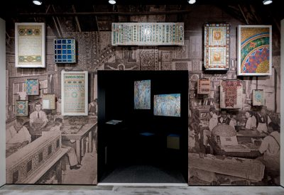 Tiffany's workshop with sample panels as seen in the exhibition Tiffany's Glass Mosaics.