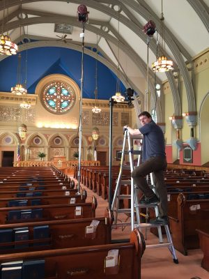 Photography department manager Andrew Fortune getting ready to photograph the Tiffany mosaics at the First Presbyterian Church in Bath, N.Y.