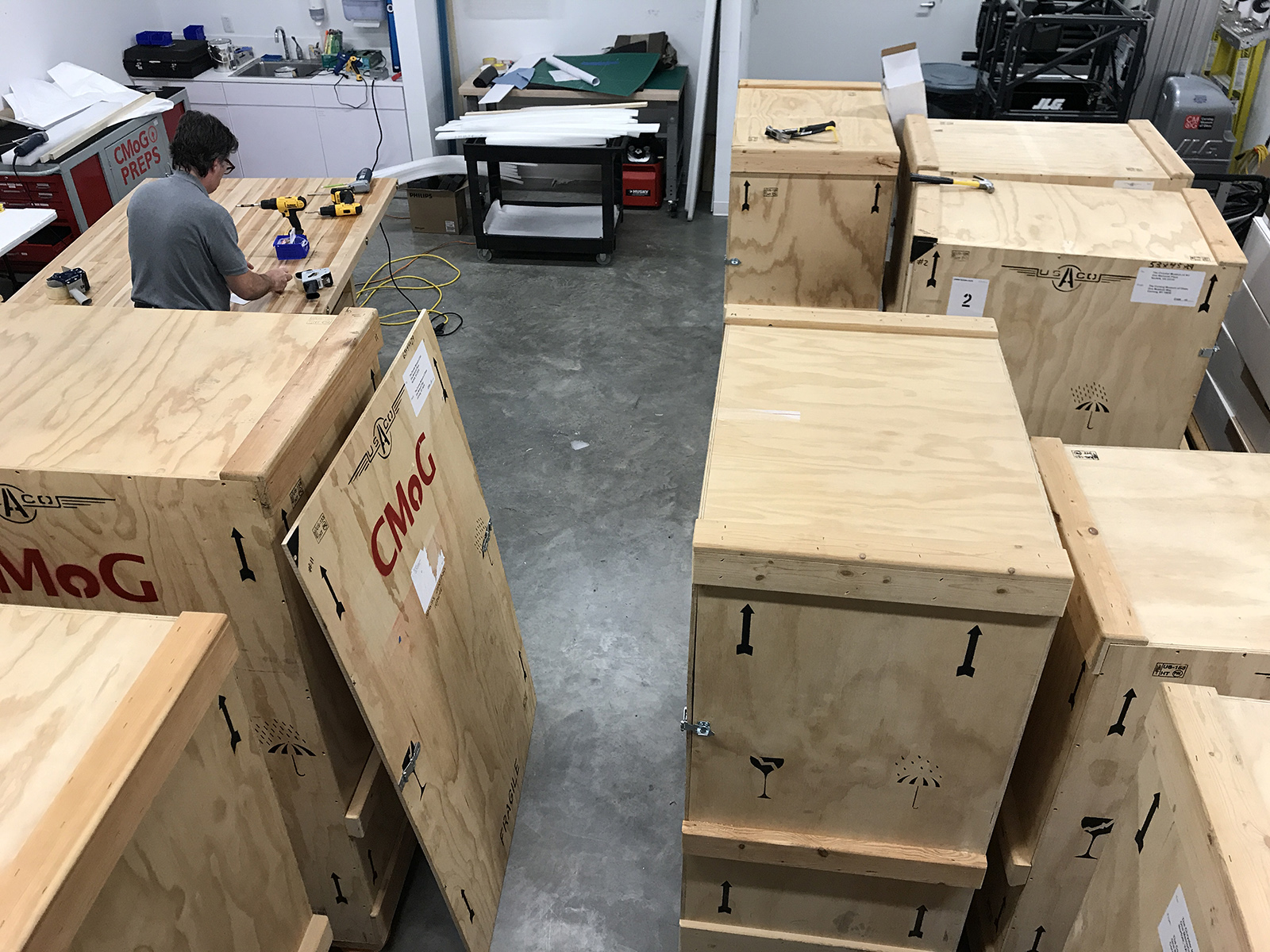 Overhead view for scale: Tom putting the final touches on the crates.