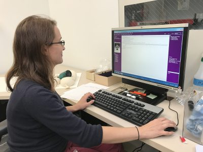 Whitney Birkett, Assistant Registrar, verifies that the objects' locations are accurate in the database.