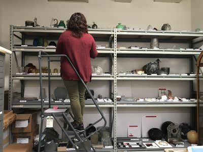 Emily Smith, Assistant Registrar, checks that loan objects are accounted for before they are packed.