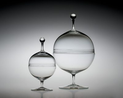 Candy Dishes, designed in 1925. Designed by Oswald Haerdtl (Austrian 1899–1959); manufactured by J. & L. Lobmeyr. Glass, mold-blown, tooled, ground and polished. H. 22.9 cm, Diam. 12.7 cm; H. 15.3 cm, Diam. 7.7 cm. The Corning Museum of Glass (64.3.43).