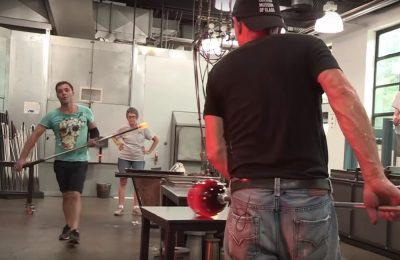 Marco (in the green shirt) prepares a punty for Davide during a class at The Studio.