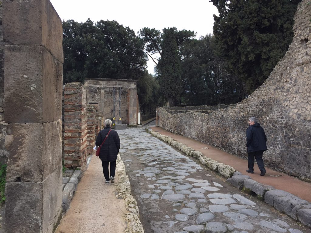 Exploring the remains of the ancient city of Pompeii, buried by the eruption of Mt. Vesuvius in A.D. 79.