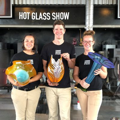 Stephanie Perry, Logan Brooks, and Kim Savoie show off their work from a recent cruise on the Celebrity Solstice.
