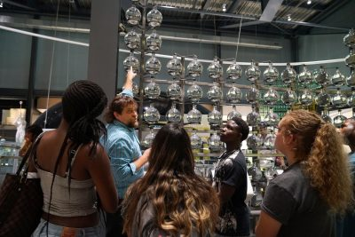 Marvin Bolt, curator of science and technology, gives students a tour of the Innovation Center.