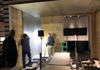 MAK Curator Rainald Franz with Preparators Tom Oberg and Steve Hazlett securing wall panels.