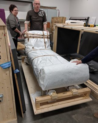 Registrar Emily Smith and MAK's curatorial assistant Harald Bauer, unpack a chaise.
