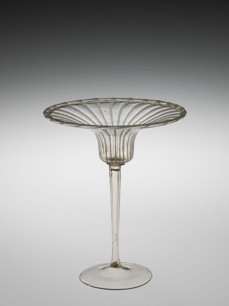 Wineglass with wide, flared rim.