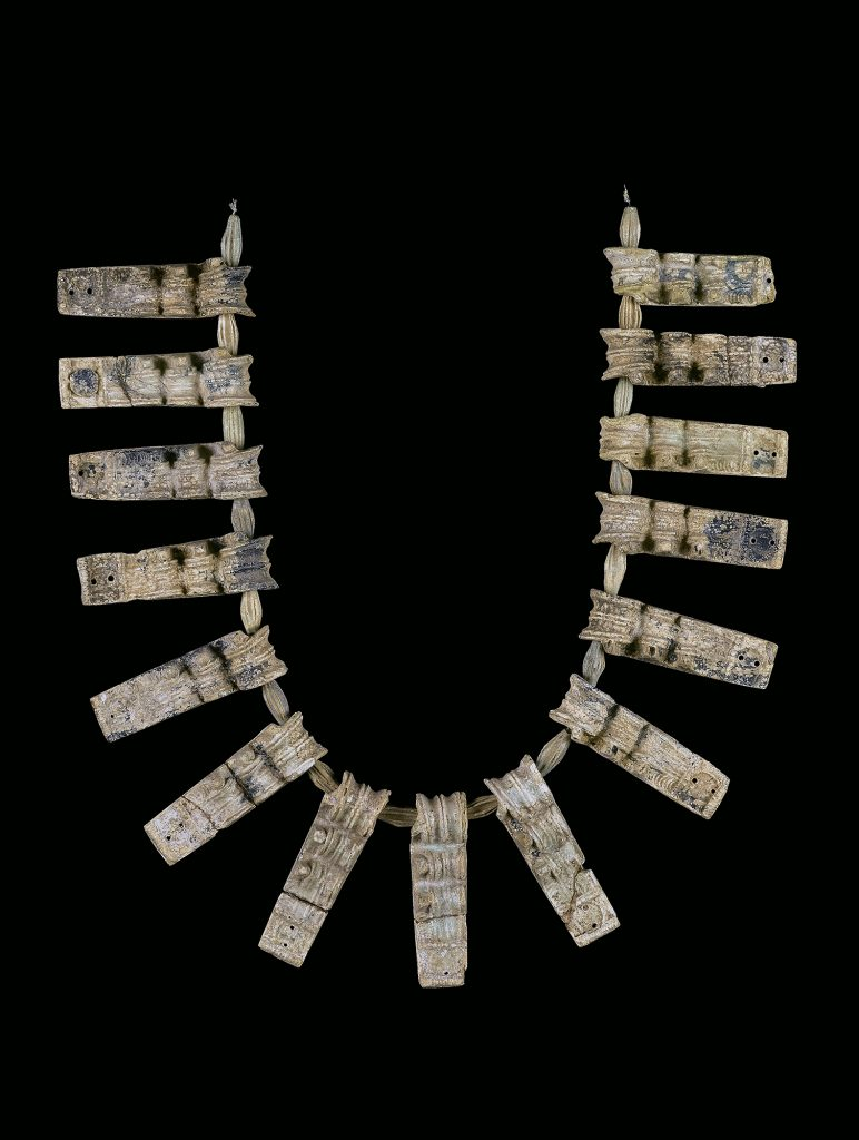 Weathered necklace with 15 pendants separated by beads