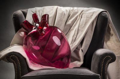 Red glass heart resting on a chair