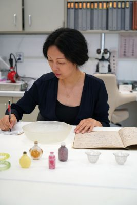 Dr. Shelly Xue working in the Museum's Conservation Lab.
