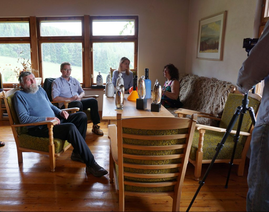 Gunter Kyne (left) being interviewed in his home