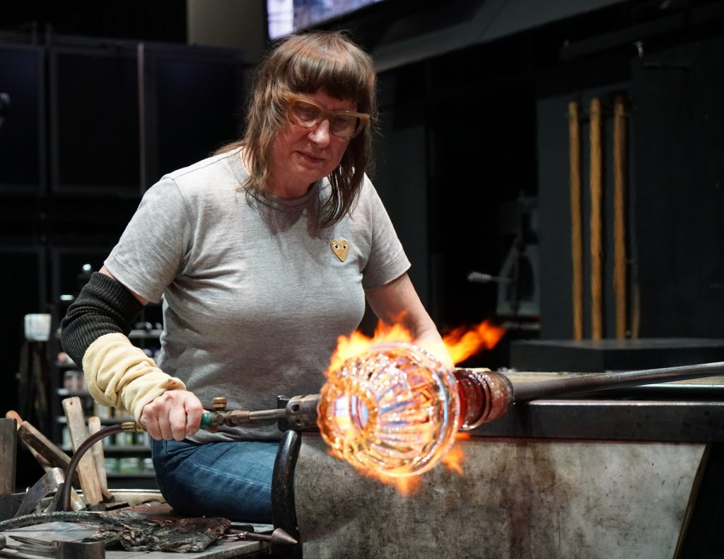 Deb Czeresko working in the Amphitheater Hot Shop at CMoG during her Blown Away winners residency