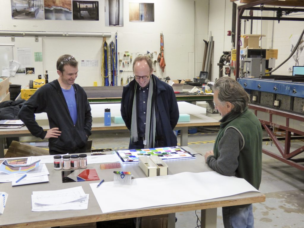Spencer Finch (center) collaborating on the fabrication of The Secret Life of Glass at Bullseye Studio of Bullseye Glass Co. in Portland, Oregon.
